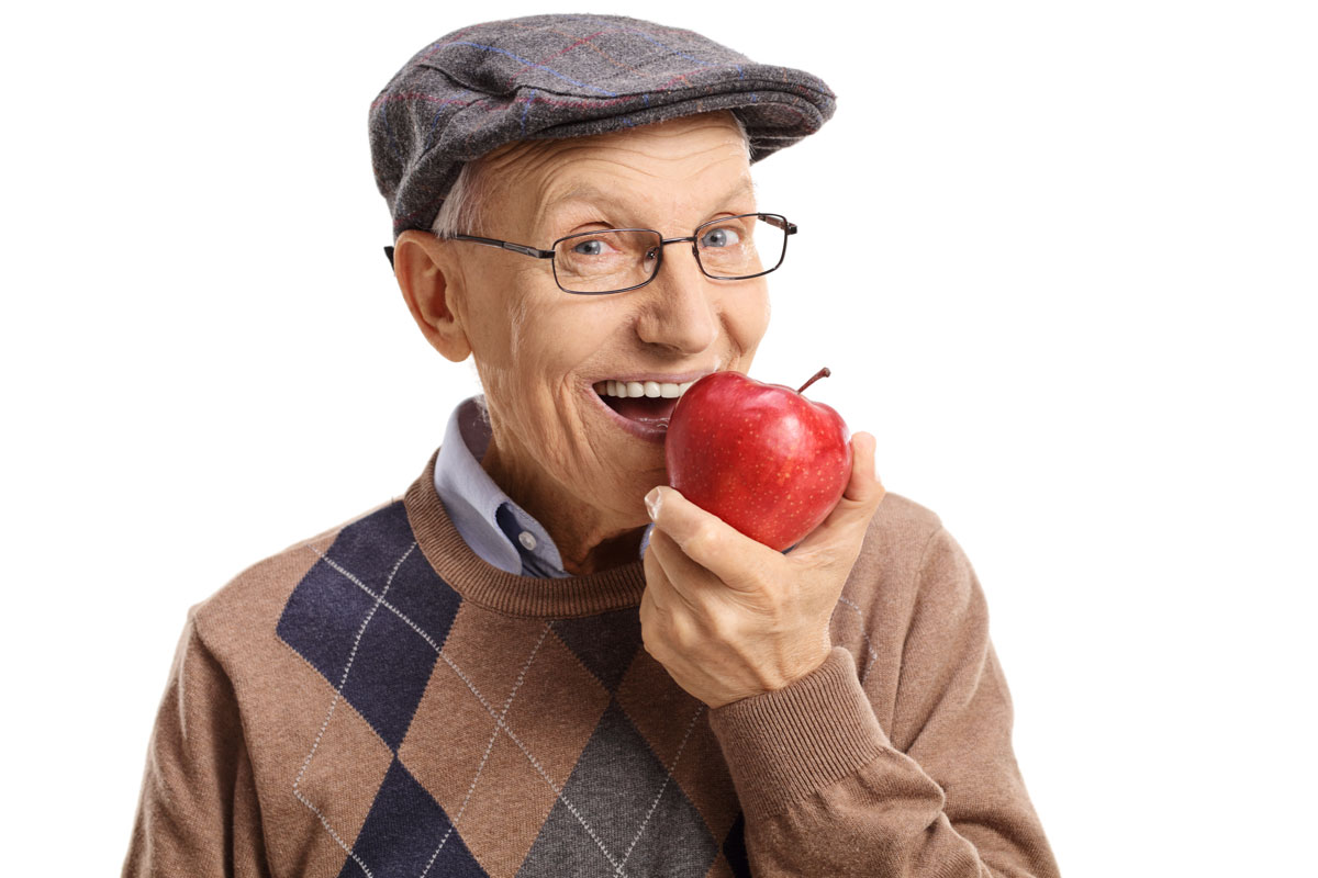 an old man with an apple in his hand